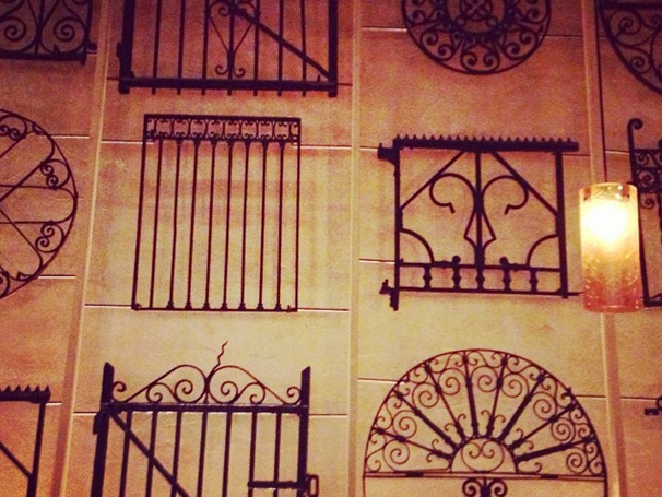 Fancy Iron gates from New Orleans flood at Emeril Lagasse us restaurant Table wall decor art