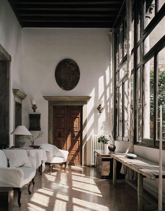 Designer: Axel Vervoordt,  Architectural Digest | plaque hung above door