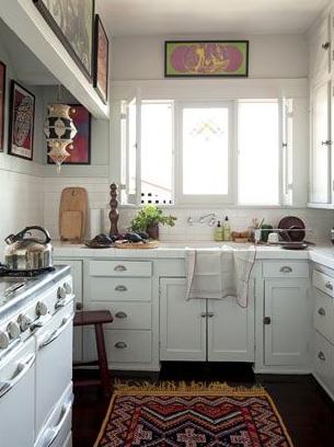 Designer:  Roman Alonso , Commune | Image via:  House Beautiful | Art hung above window, kitchen