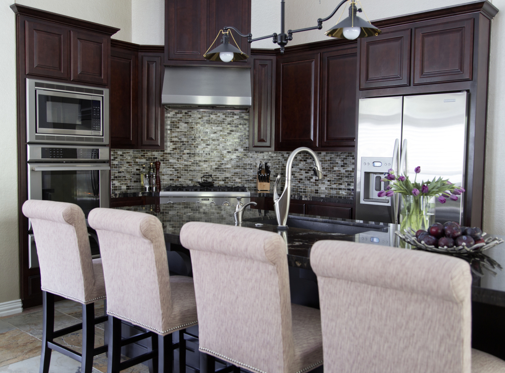 Dark, dramatic kitchen remodel by interior designer Carla Aston