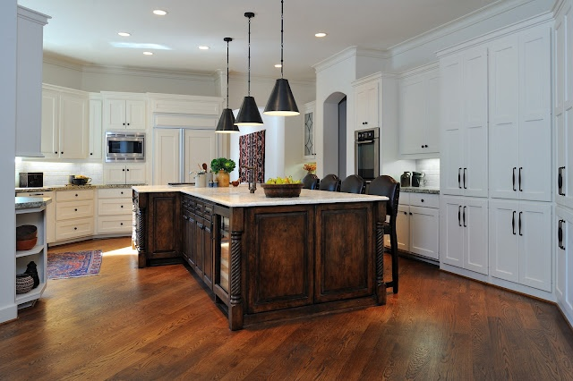 Kitchen with satin finish trim, designed by interior designer Carla Aston.
