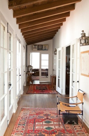 Oriental Persian rug, hallway |Home of  Joan Tanner  | Image source:  Apartment Therapy