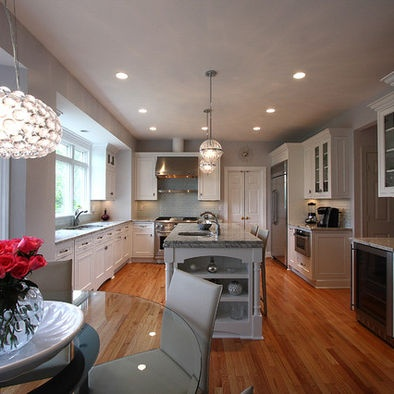 Kitchen island; wood floor; decorative light | Design -er: NVS Remodeling & Design