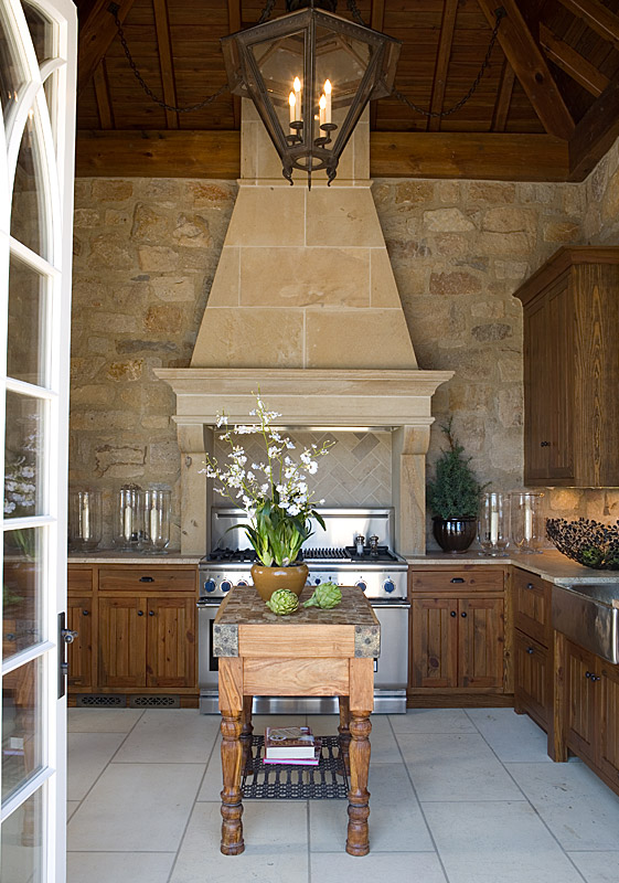 Kitchen; wood island; hood | Design -er: Gordon Beall
