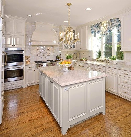 Kitchen lighting; wood floor; island | Design -er: Carla Aston