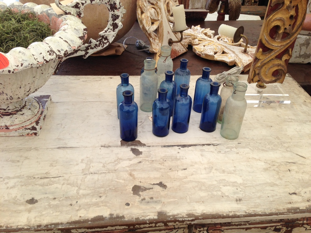 Antique furniture, decor;  Colorful bottles