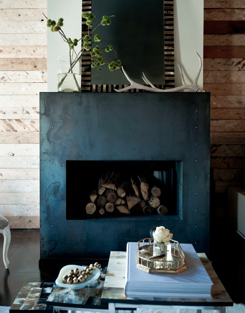 Mantel decorated with branches. | Interior Designer: Jamie Laubhan-Oliver