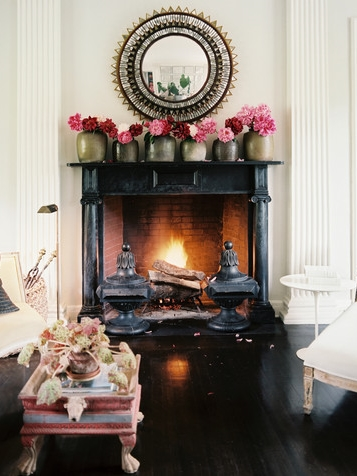 Decorate your mantel using the repetition of an decorative object. | Interior Designer: John Dransfield & Geoffrey Ross
