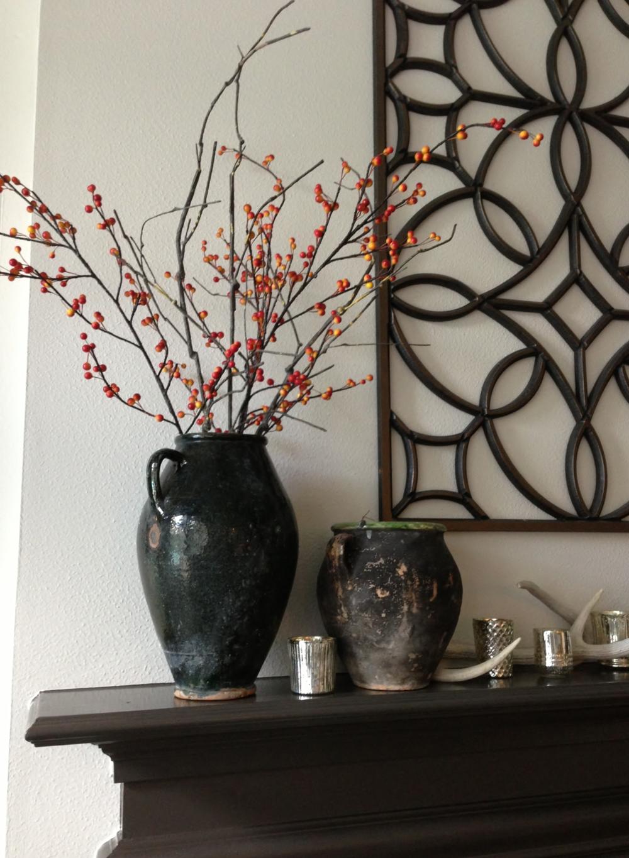 This mantel is decorated with rustic vases. | Interior design -er: Carla Aston