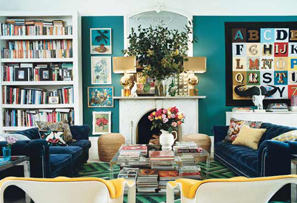 fireplace; bookshelf; outlet on mantel; lamp; art | Home of christopher and suzanne sharp