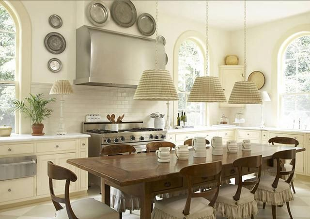 Decorate with, hang, pewter plates; kitchen as dining room | Interior Design -er: Suzanne Kasler