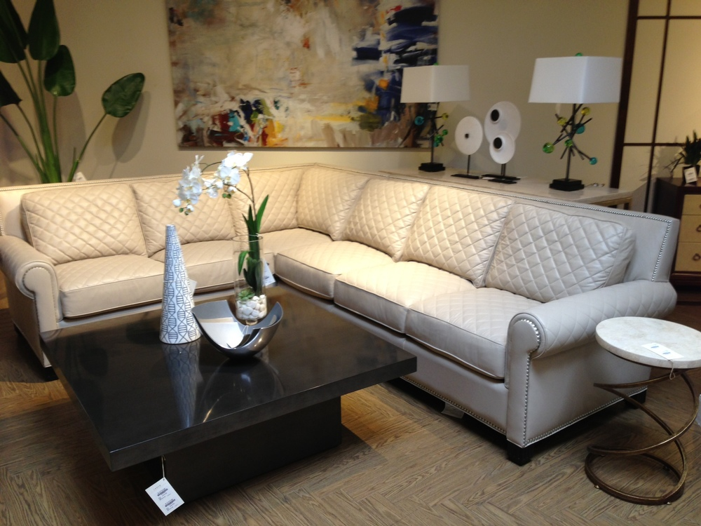 quilted leather sofa / couch; table; lamps; decor
