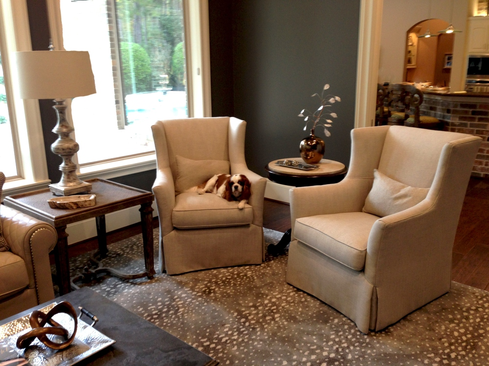 Classy living room designed by Carla Aston | chair; lamp; coffee table