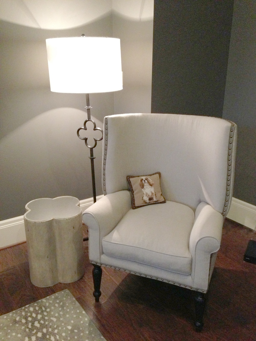 Classy living room designed by Carla Aston | floor lamp; wingback chair