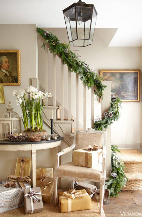 step into the christmas spirit with a garland draped staircase designed. Black Bedroom Furniture Sets. Home Design Ideas