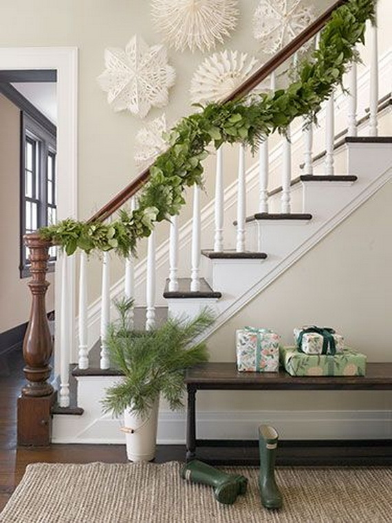House entryway; staircase; Christmas garland | Img source: Country Living