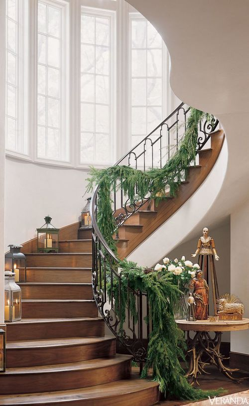 "MUST-HAVE: STEP INTO THE CHRISTMAS SPIRIT WITH A GARLAND-DRAPED STAIRCASE!  ➤ http://carlaaston.com/designed/garland-staircase-christmas | ""I couldn't wait to finally have a house with an open stair so I could have my first Christmas with boughs swagged down the railings. They create such a luxurious, grand, celebratory look for the holidays. Don't you think?"" 