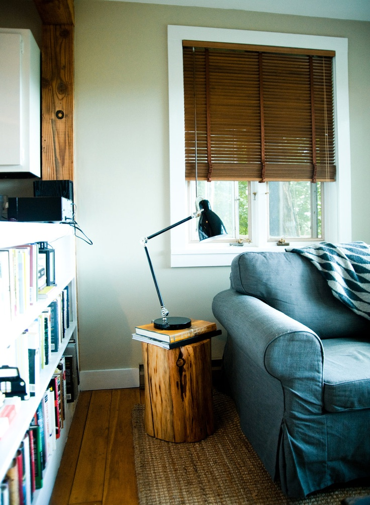 Wood blinds; book shelf; couch; lamp | Img source: NYTimes.com