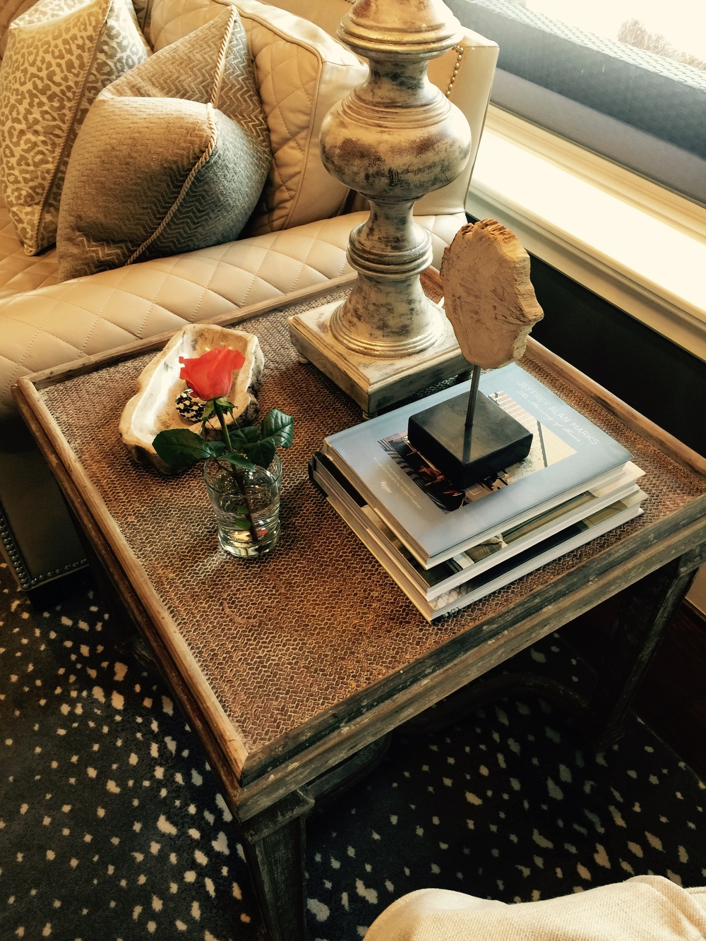 End table in the room where the coffee table will be styled; home decor / decorating | Interior Designer: Carla Aston