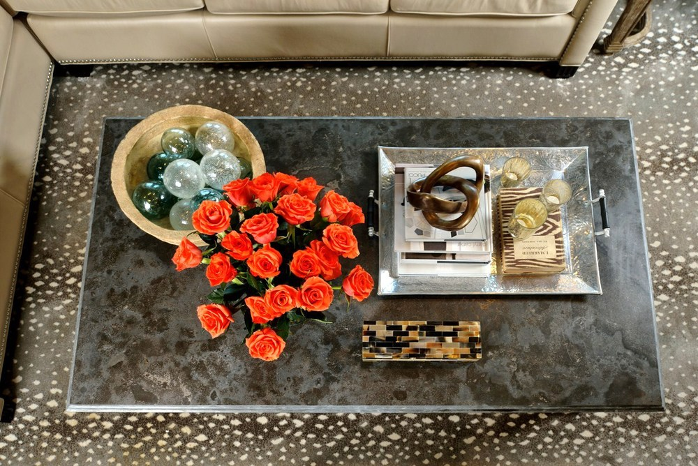 Featured / pictured in article: coffee table, style -ed; living room; sofa; candle;   flowers; interior design book; tray, knot, box, bowl, glass ball, etc. decor | Styling done by interior designer Carla Aston