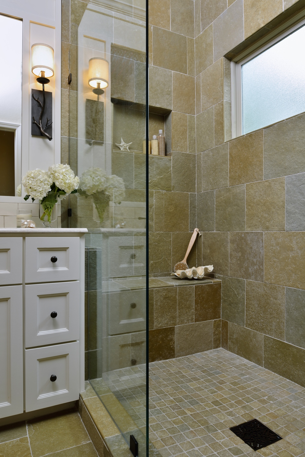 Interior Designer: Carla Aston | Garden inspired bathroom; slate floor; shower, shampoo niche / Photographer: Miro Dvorscak