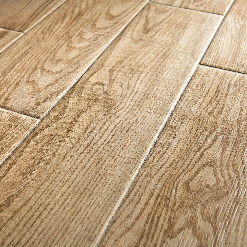 Pictured: wood look tile flooring - Natural Wood Floors Vs. Wood Look Tile Flooring: Which Is Best For