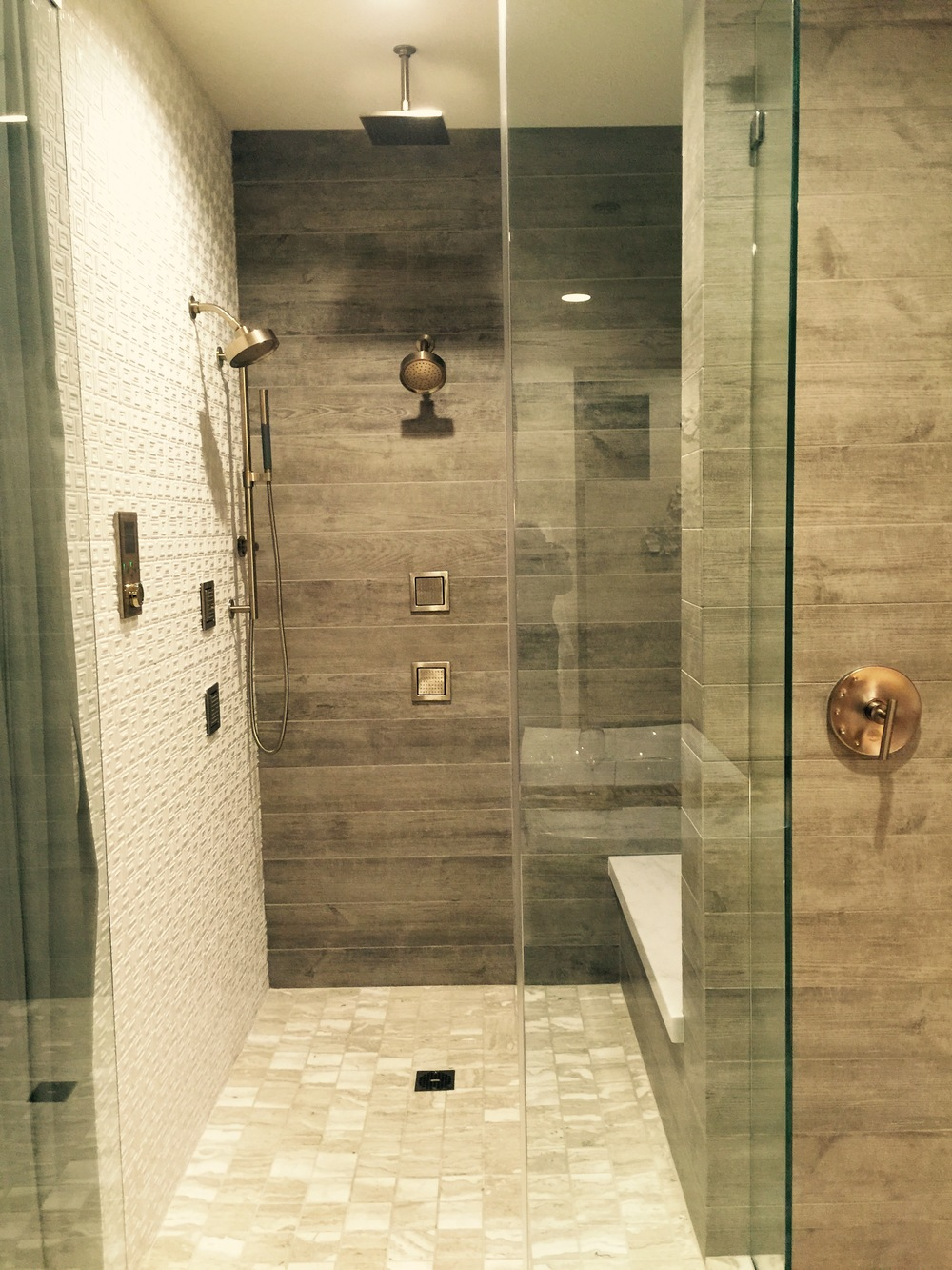 Master shower featuring wood look tile, which looks awesome, btw! We know it's not real wood, but it's bringing a natural look to the space.