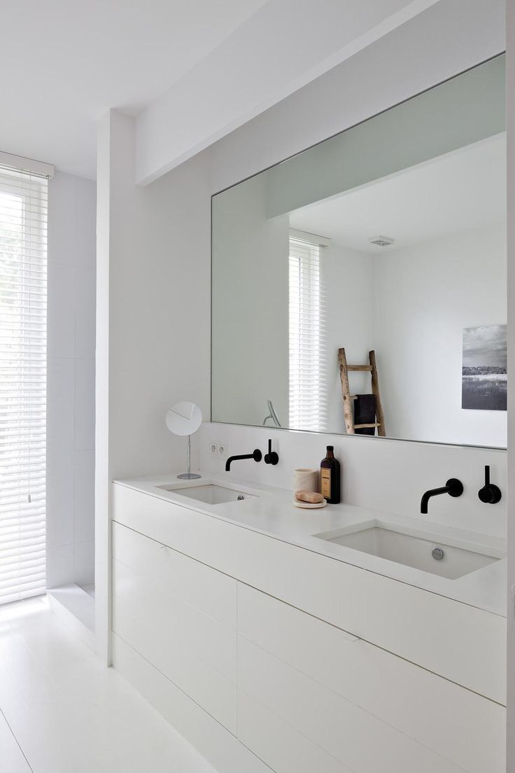 Pictured in this bathroom: black faucet; sink; countertop; mirror | Image source: oscarv.com