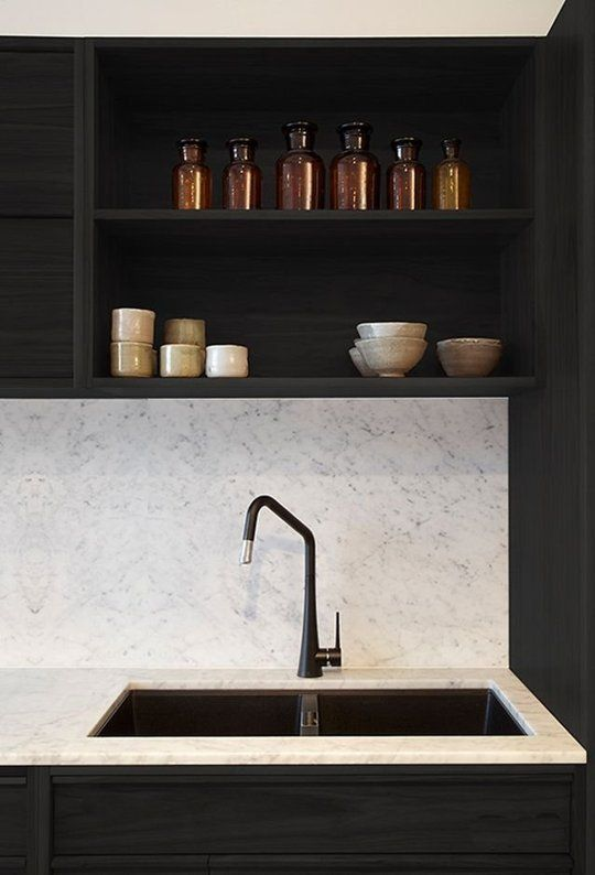Pictured in this kitchen: black faucet; sink; countertop | Image source: apartment therapy