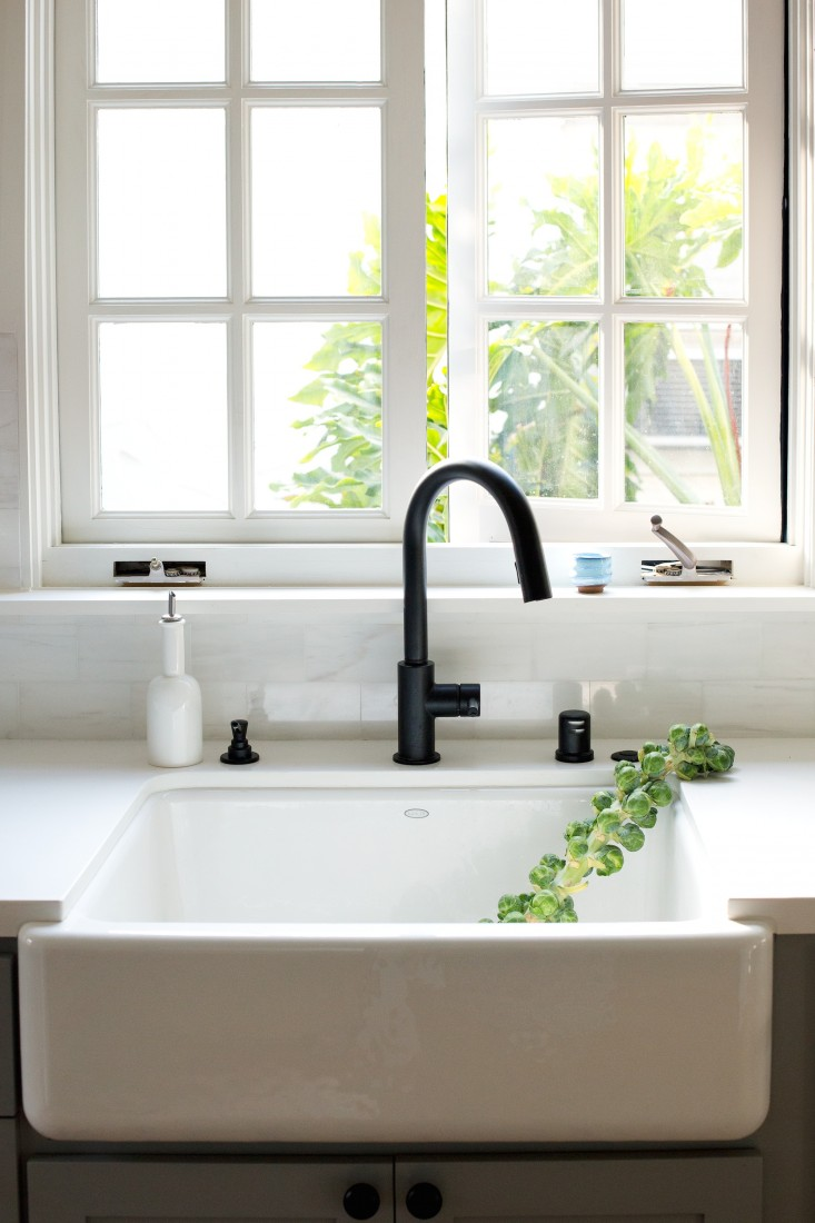 Pictured in this kitchen: black faucet; sink; countertop | Image source: remodelista.com