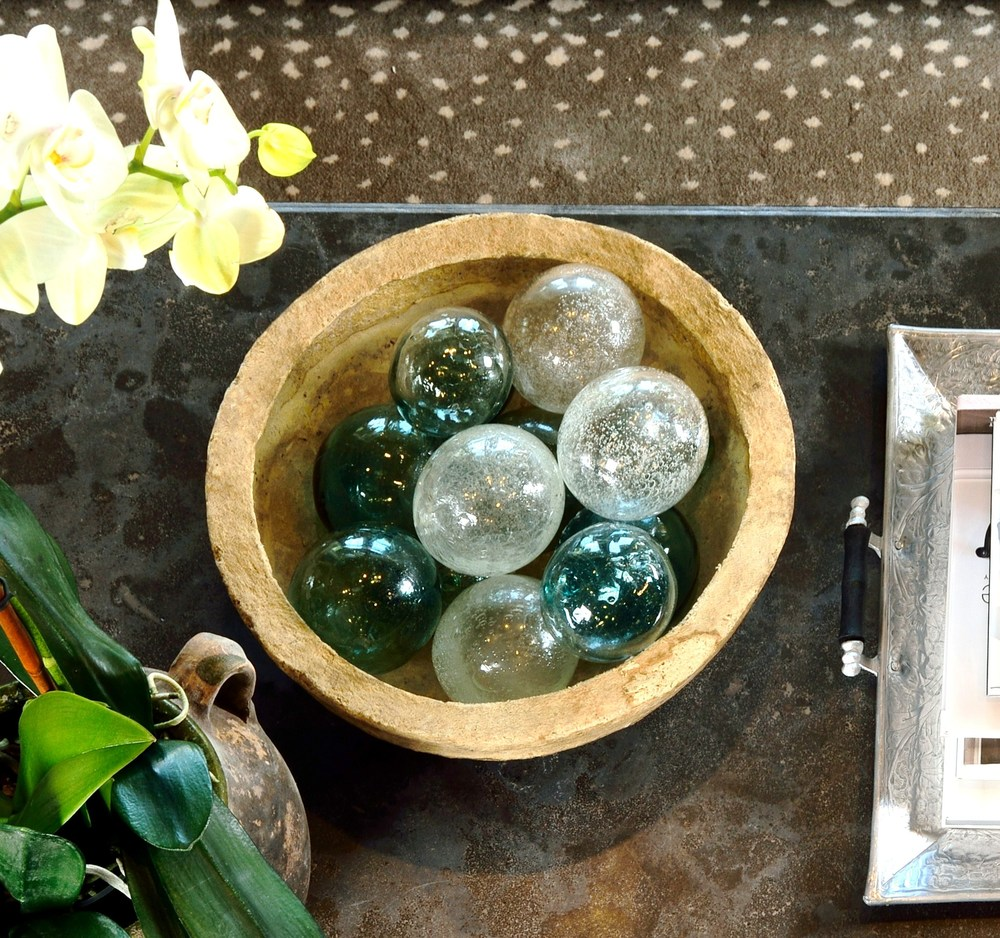 CLICK HERE    to see some of these unique decor pieces on this coffee table I styled!