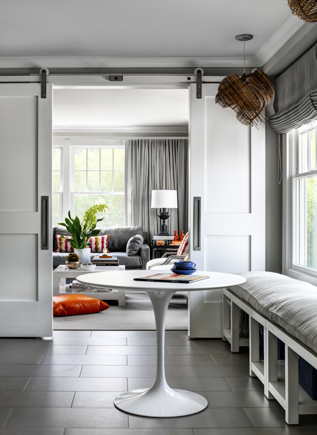 MUST-SEE:  Inside A Beautiful Connecticut Beach House That Has Us Dreaming Of Summer  >  http://www.huffingtonpost.com/2015/02/16/connecticut-beach-house-tour_n_6673746.html?utm_hp_ref=house-tour  —  You're going to love this beach house remodel! Right now, I couldn't be more into barn doors. I find them to be oh-so functional and aesthetically pleasing. This particular home has a great pair of them, as well as some spectacular lighting, which is something I think everyone should invest in, as it's brilliant at giving a home some personality and pizazz.    | Image Source: Huffpo.com