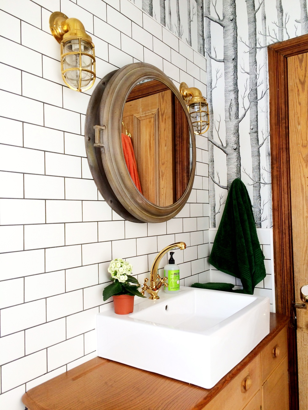 Home / apartment bathroom decor; mirror; lighting; sink | Remodeled by Deborah Peterson Milne