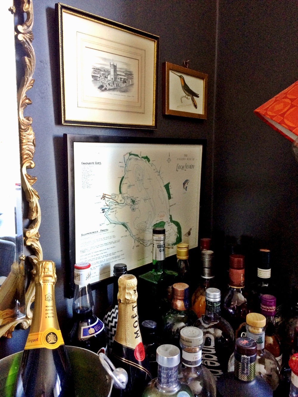 Home / apartment decor; wine; champagne; liquor bottle; map; frame; mirror | Remodeled by Deborah Peterson Milne