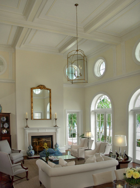 Living room ceiling treatment; couch; chair; lamp; lighting; mirror | Home builder John McDonald Company