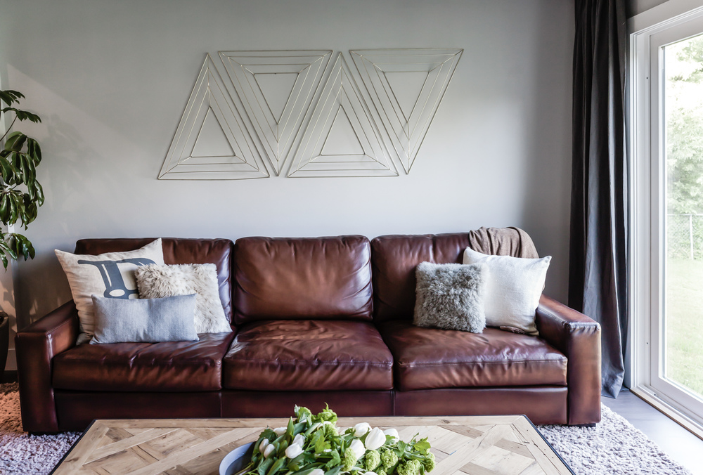Living room remodel; leather couch; pillow; coffee table; decor; wall art | Interior Designer: Matt Tsang