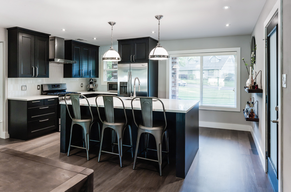 Kitchen remodel; bar chair; island; cabinetry; lighting; refrigerator; sink | Interior Designer: Matt Tsang