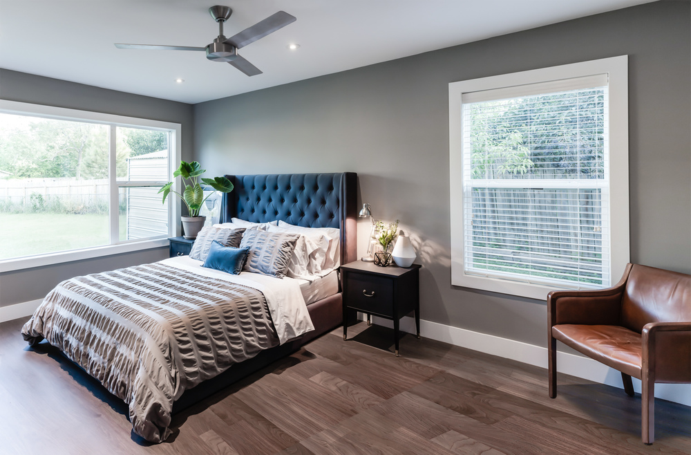 Bedroom remodel; bed; wood flooring; chair; window; headboard; ceiling fan; leather chair | Interior Designer: Matt Tsang