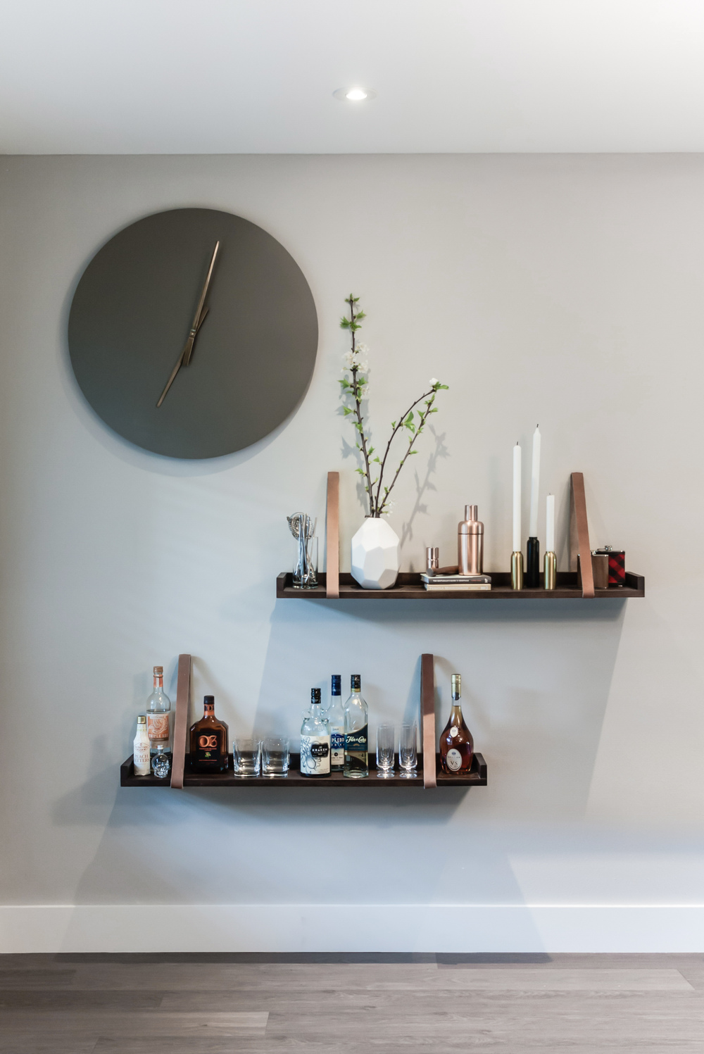 Home remodel; wall decor; shelving; clock | Interior Designer: Matt Tsang