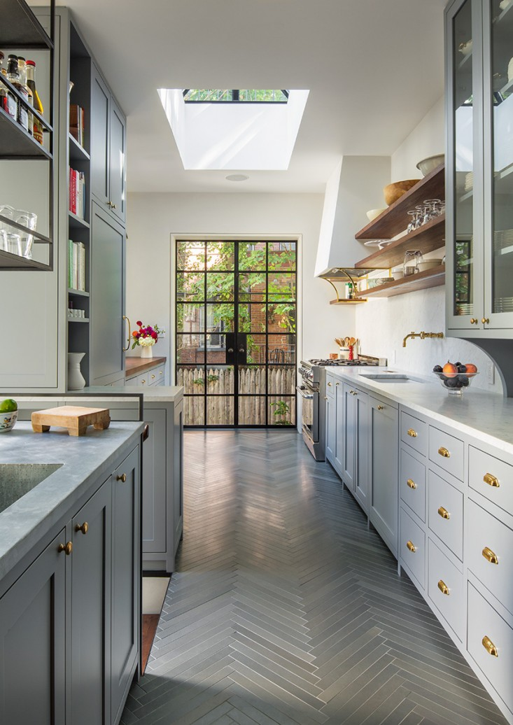 MUST-SEE: The Architect Is In: A Brooklyn Brownstone Transformed, with Respect > http://www.remodelista.com/posts/modern-kitchen-with-ties-to-the-past-in-a-historic-brooklyn-brownstone-by-architect-gerry-smith — I just love this remodel. Not only are the materials, the clean details, the color palette, the lighting, and the hardware some of my faves, but... I love the way the bar was incorporated at the stair! (And, btw — that brass chalkrail: it's simply beautiful!)   | Architect: Gerry Smith