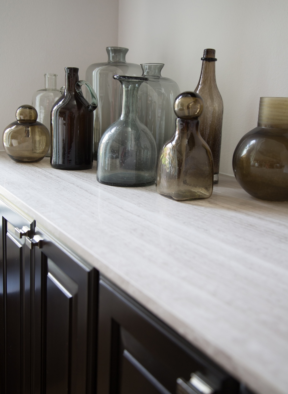 decorative bottles, interior styling | Interior Designer: Carla Aston / Photographer: Tori Aston