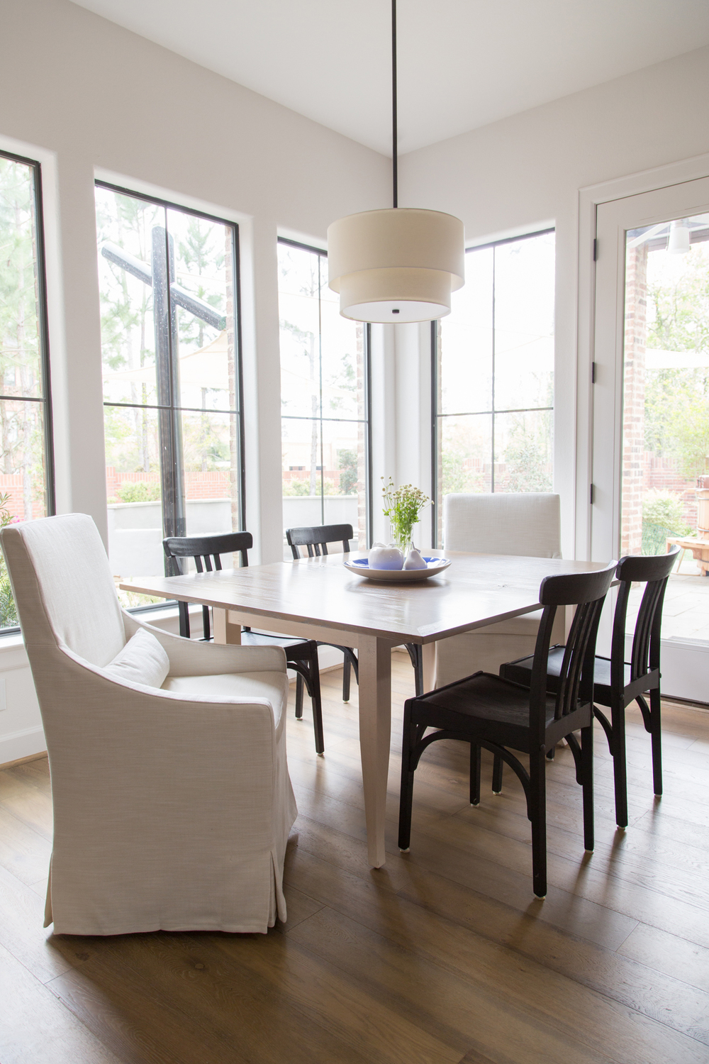 breakfast room table; chair; wood flooring; lighting | Interior Designer: Carla Aston / Photographer: Tori Aston