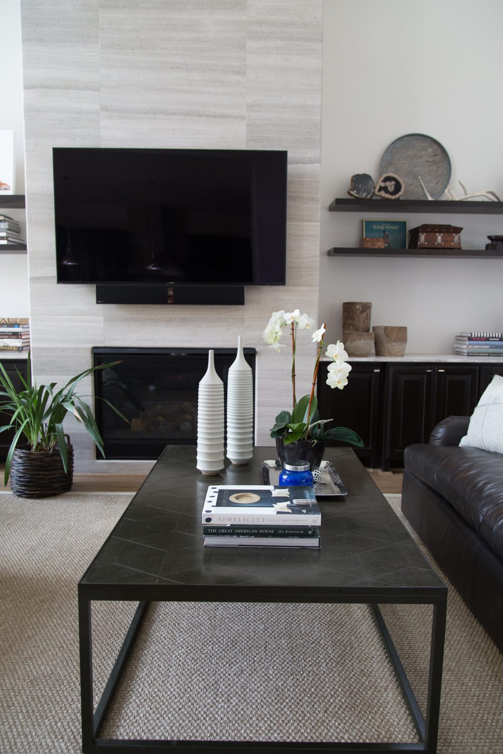 living room remodel; coffee table; decor; television; shelving | Interior Designer: Carla Aston / Photographer: Tori Aston