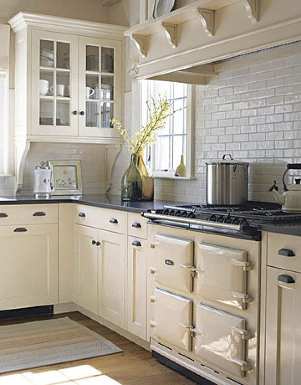 Cream and white color kitchen; stove; cabinetry | Interior Designer: Susan Tully