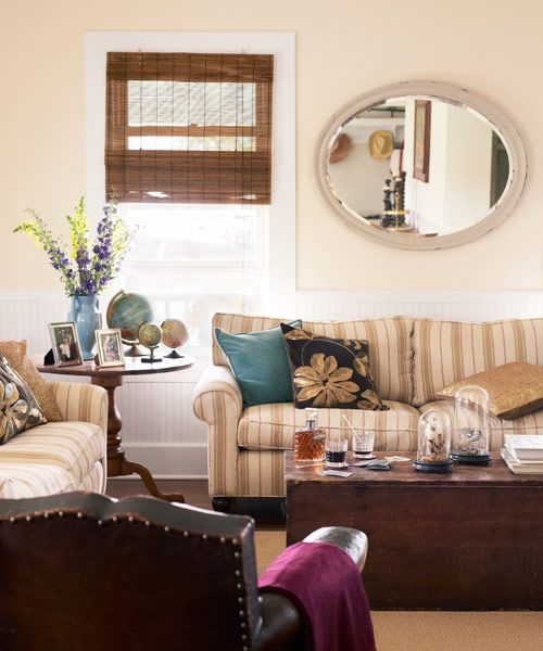 cream and white color living room; sofa; chair; mirror | Homeowners: Lisa & Mark Hellman