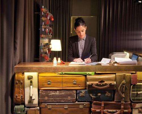 "Hotel design trend: luggage used as decor | ""Chic & Basic Ramblas Hotel / Image source: Design Milk"