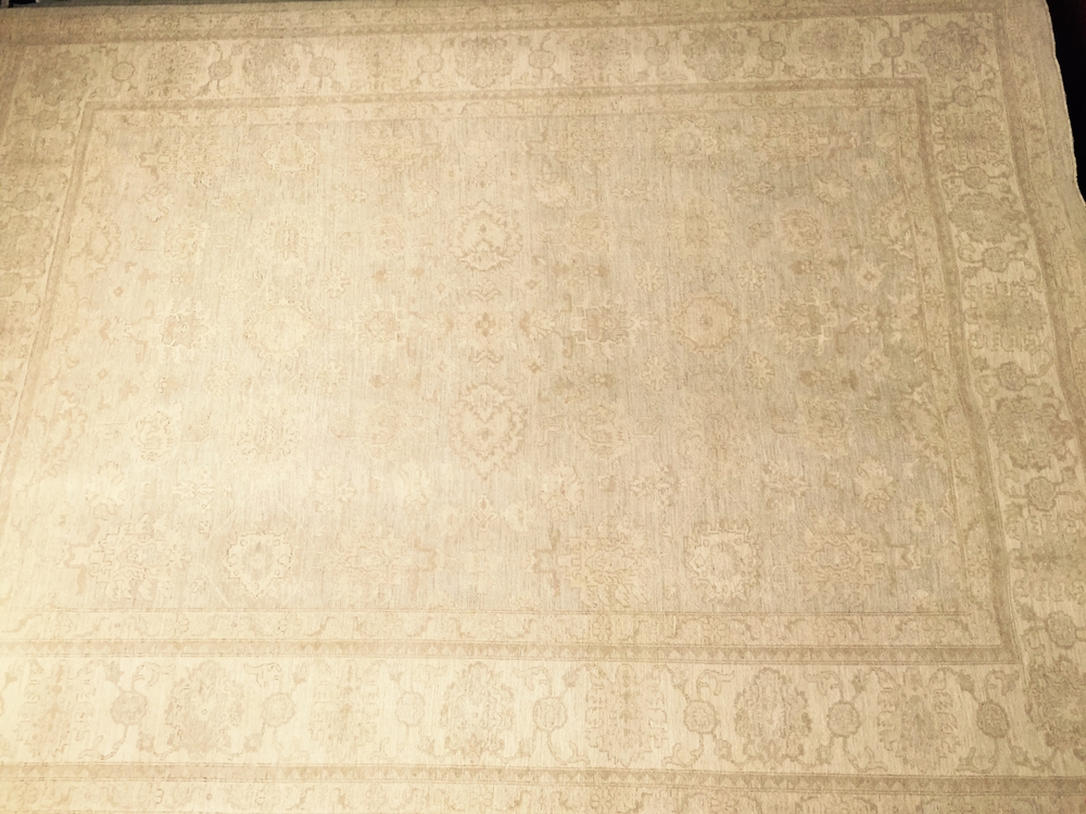 This rug — a 10 x 14 cream colored Oushak — cost me $6500, wholesale. Now I want it to be yours for a modest price of...