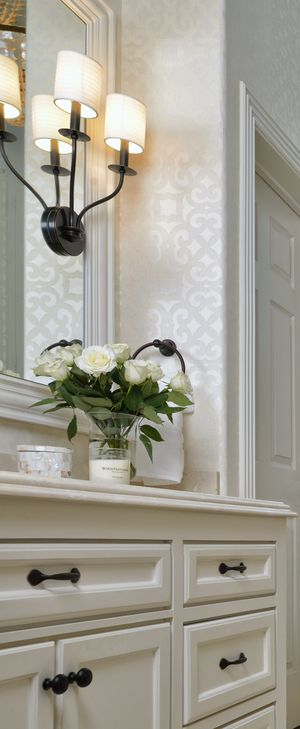 Bathroom sconce, sink, mirror, backsplash, lighting, decor, cabinet, design | Interior Designer: Carla Aston