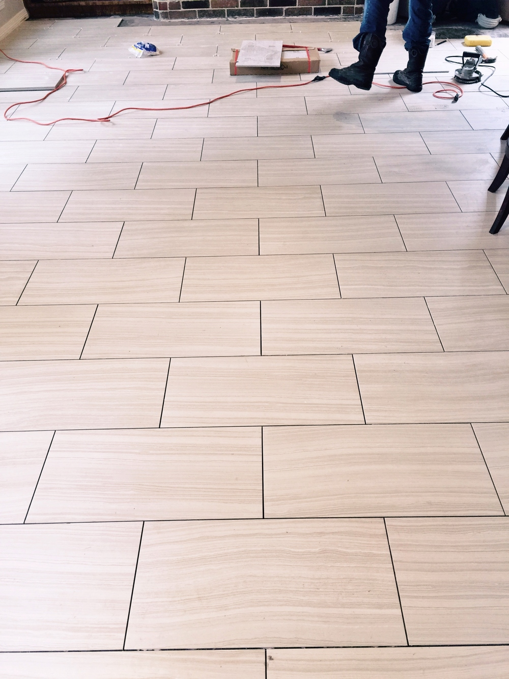 12 X 24 Tile Floor Being Laid Across The Narrow Width Of The Room To Make
