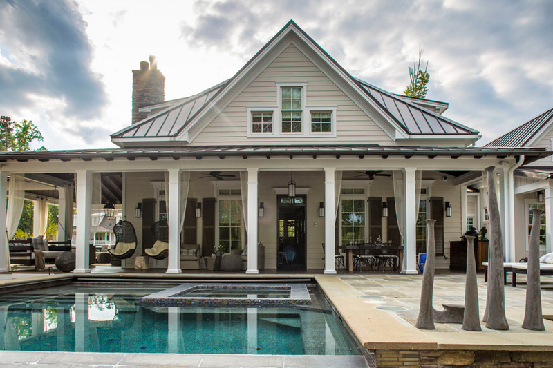 MUST-SEE: A Lakeside Weekend Home > http://www.desiretoinspire.net/blog/2015/7/22/a-lakeside-weekend-home.html — You're gonna die when you see this outdoor space. I love how the columns and drapery are white and the ceiling is dark wood. It looks fresh and light but feels like such a cool, inviting respite from summer heat. Wow. Really, WOW. | Interior Designer: Heather Garrett